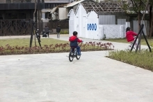 a kid riding a bike in the park